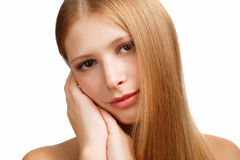 Tenderness. Young beautiful woman with long blond hair touchs her face isolated on white background Stock Image