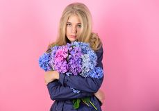 Tenderness of young skin. Springtime bloom. Simple beauty. Girl cute blonde hug hydrangea flowers bouquet. Natural stock photography