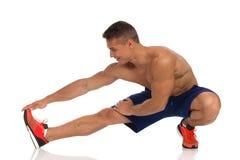 Tendine del ginocchio che allunga esercizio Immagini Stock Libere da Diritti