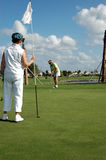 Tending flag on golf green