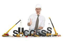 Tendo o sucesso: Sucesso-palavra da construção do homem de negócios. Fotografia de Stock