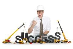 Tendo o sucesso: Sucesso-palavra da construção do homem de negócios. Fotos de Stock
