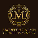 Tendrils gold letters with M initial monogram.