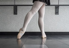 Tendu Derriere Ballet Style. Ballet dancer at the barre doing a tendu derriere Royalty Free Stock Photography