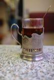 Tenedor de cristal con té Fotos de archivo libres de regalías