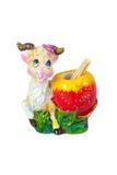 Tenedor decorativo del recuerdo de la cabra para los palillos aislado en blanco Fotografía de archivo