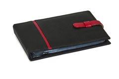 Tenedor del libro de batería aislado en el fondo blanco Imagen de archivo