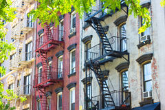 Tenement Apartments. A row of historic New York City tenement apartment buildings from the 19th century royalty free stock image