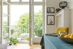 Tenement house with a balcony decorated with plants. Close-up of fruit on a table stock photos