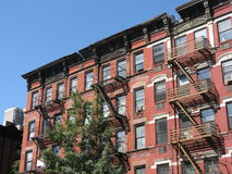 Tenement style apartments, New York City. A row of tenement style apartment buildings on the Upper East Side of Manhattan, New York City. This neighborhood Stock Photography