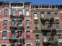 Tenement style apartments, New York City. A row of tenement style apartment buildings on the Upper East Side of Manhattan, New York City. This neighborhood Stock Image