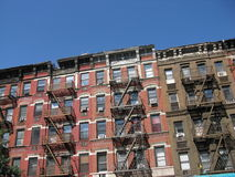 Tenement style apartments, New York City. A row of tenement style apartment buildings on the Upper East Side of Manhattan, New York City. This neighborhood Royalty Free Stock Images