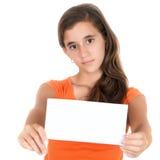 Tenencia adolescente hispánica una muestra en blanco Fotos de archivo