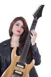 Tenencia joven atractiva hermosa de la muchacha del músico Foto de archivo