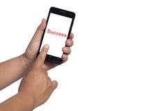 Tenencia y tacto de la mano en Smartphone negro Imagen de archivo