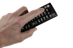 Tenendo un telecomandato io la mano sinistra fotografie stock libere da diritti