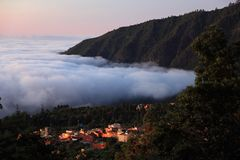 Tenerife - Aguamansa. Tenerife - night scene showing the city Aguamansa in the valley of Orotava above the clouds Stock Image