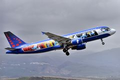 TENERIFE APRIL 10: plane taking off, with the Smurfs, April 10, Stock Photo