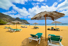 Tenerife beach. Umbrellas and chairs on the Fanabe beach, in Tenerife village, on summer season Stock Photo