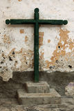 Tenerife crucifix. Old wooden crucifix against colourful wall Stock Photo
