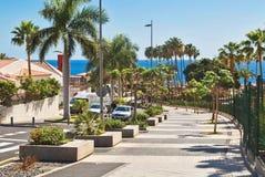 Pedestrian road to the sea along avenida Eugenio Dominguez Alfon. TENERIFE ISLAND, SPAIN - APRIL 10, 2017 : Pedestrian road to the sea along avenida Eugenio Stock Image