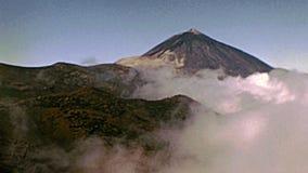 Tenerife island Teide peak. Peak with fog of the Teide Volcano mountain in Teide National Park. Historical archival of Tenerife island of Spain in Africa in stock footage