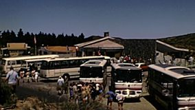 Tenerife island touristic bus at Teide volcano. Tenerife, Spain - Circa 1976: Volcano Teide in Teide National Park, touristic bus with people visiting stock video