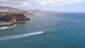 Tenerife, La Caleta, Spain - May 18, 2018: Aerial view of Atlantic ocean and boat, Canary islands. Tenerife, La Caleta, Spain - May 18, 2018: Aerial view of stock video