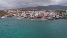 Tenerife, La Caleta, Spain - May 18, 2018: Aerial view rocky coast of Atlantic ocean, Canary islands. Tenerife, La Caleta, Spain - May 18, 2018: Aerial view stock footage