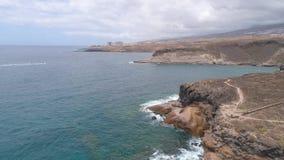 Tenerife, La Caleta, Spain - May 18, 2018: Aerial view rocky coast of Atlantic ocean, Canary islands. Tenerife, La Caleta, Spain - May 18, 2018: Aerial view stock video footage
