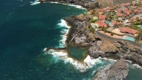 Tenerife, Los Gigantes, Spain - May 18, 2018: Aerial view rocky coast and hotels, Canary islands. 4K drone shot from above stock footage