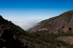 Tenerife mountains. Scenic landscape of forested mountains with cloudscape and blue sky background, Tenerife, Canary Islands, Spain royalty free stock photos