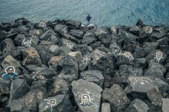TENERIFE, SPAIN – May 30, 2018: Rocks with painting portraits of famous musicians near Auditorio de Tenerife.  royalty free stock images