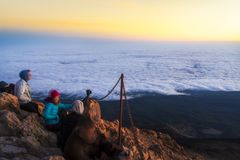 Hikers watching sunrise from top of the El Teide volcano royalty free stock image