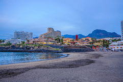 TENERIFE SPAIN - Dec 2012: Las Americas beach with hotels in the evening Royalty Free Stock Photo