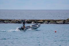 TENERIFE, SPAIN - DEC 2012: Man in rubber motorboat on December 6, 2012.  stock image