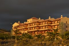 Modern hotel and arid landscape of Tenerife Canary Islands stock photography