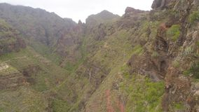 Tenerife, Spain - May 18, 2018: Aerial view of rocky mountains in Hell gorge, Canary islands. 4K drone shot from above stock video footage