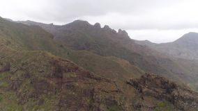 Tenerife, Spain - May 18, 2018: Aerial view of rocky mountains in Hell gorge, Canary islands. 4K drone shot from above stock video