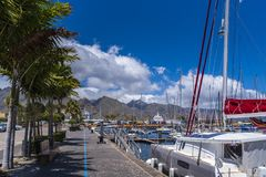 Boating port with larger sailboats lying in front of Santa Cruz de Tenerife. Tenerife, Spain - May 1 2019: Boating port with larger sailboats lying in front of royalty free stock photo