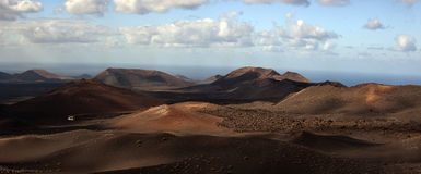 Tenerife Volcanoes, Canary Islands. A panoramic view of a bus  driving through the volcanic landscape of Tenerife, Canary Islands, of the coast of west Africa Royalty Free Stock Photography