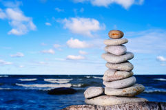 Tenet. Pile of pebble on the edge of the block Royalty Free Stock Images