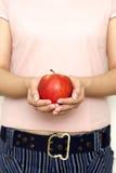 Tenga una manzana Fotos de archivo