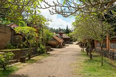 Tenganan Village in Bali. Tenganan is a village in the regency of Karangasem in Bali, Indonesia. Before the 1970s was known by anthropologists to be one of the Stock Image