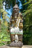 Statue in Tenganan Village in Bali. Tenganan is a village in the regency of Karangasem in Bali, Indonesia. Before the 1970s was known by anthropologists to be Royalty Free Stock Photos