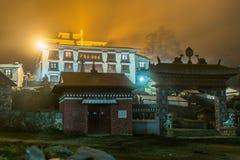 Tengboche buddhist monastery building lights at night, Nepal. Tengboche buddhist monastery building gate lights night. Tengboche village, Nepal traveling Royalty Free Stock Image