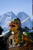 Tengboche Monastery. Closeup of dragon statue in front of Tengboche Monastery with Nup and Lho mountains in background, Khumbu, Nepal Stock Photo