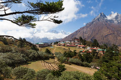 Tengboche mountains village buildings high view . Stock Photo
