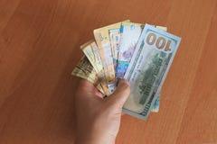 Tenge del Kazakh y los dólares del americano del dinero Foto de archivo libre de regalías