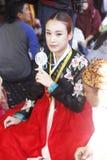 Tenggarong, July 2017 Korean girl who are using a mini fan parti Royalty Free Stock Photo